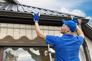 Gutter Installer quality checking the gutters